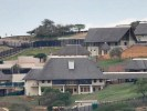 VBS liquidators want Nkandla; Hawks investigate Malema; Mine strikes; Discovery share perks up